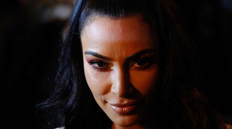 6bc1230e2e3 Kim Kardashian attends the Versace Pre-Fall 2019 fashion