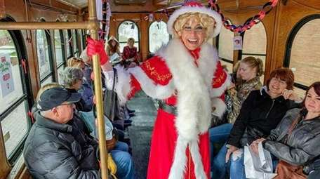 Ann Votaw rides the Holly Trolley in her