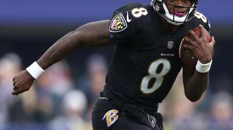 BALTIMORE, MD - NOVEMBER 18: Quarterback Lamar Jackson