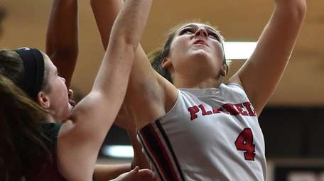 Plainedge's Charlotte Cavaliere draws a shooting foul during