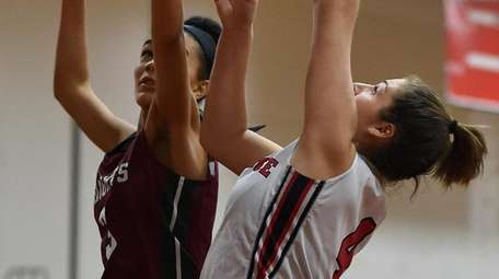 Charlotte Cavalier #4 of Plainedge, right, shoots from
