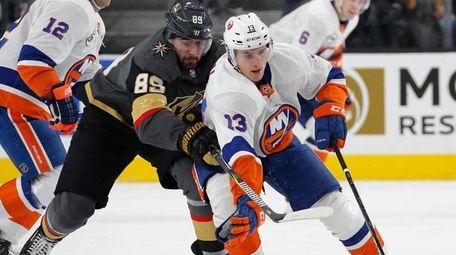 New York Islanders center Mathew Barzal (13) skates