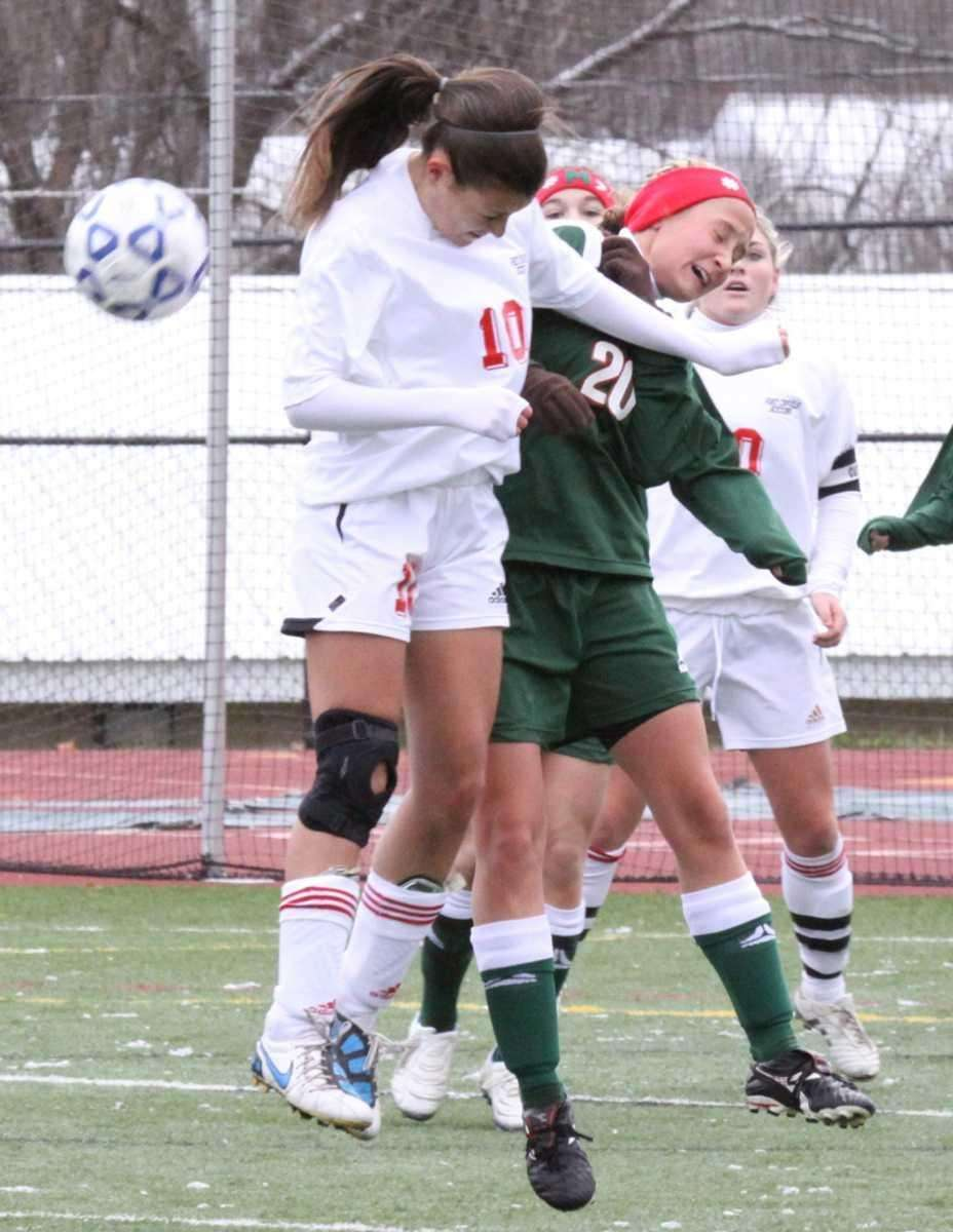 Center Moriches Claire Brady heads the ball up