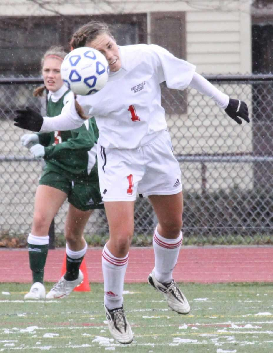 Center Moriches Renee Nelson heads the ball up