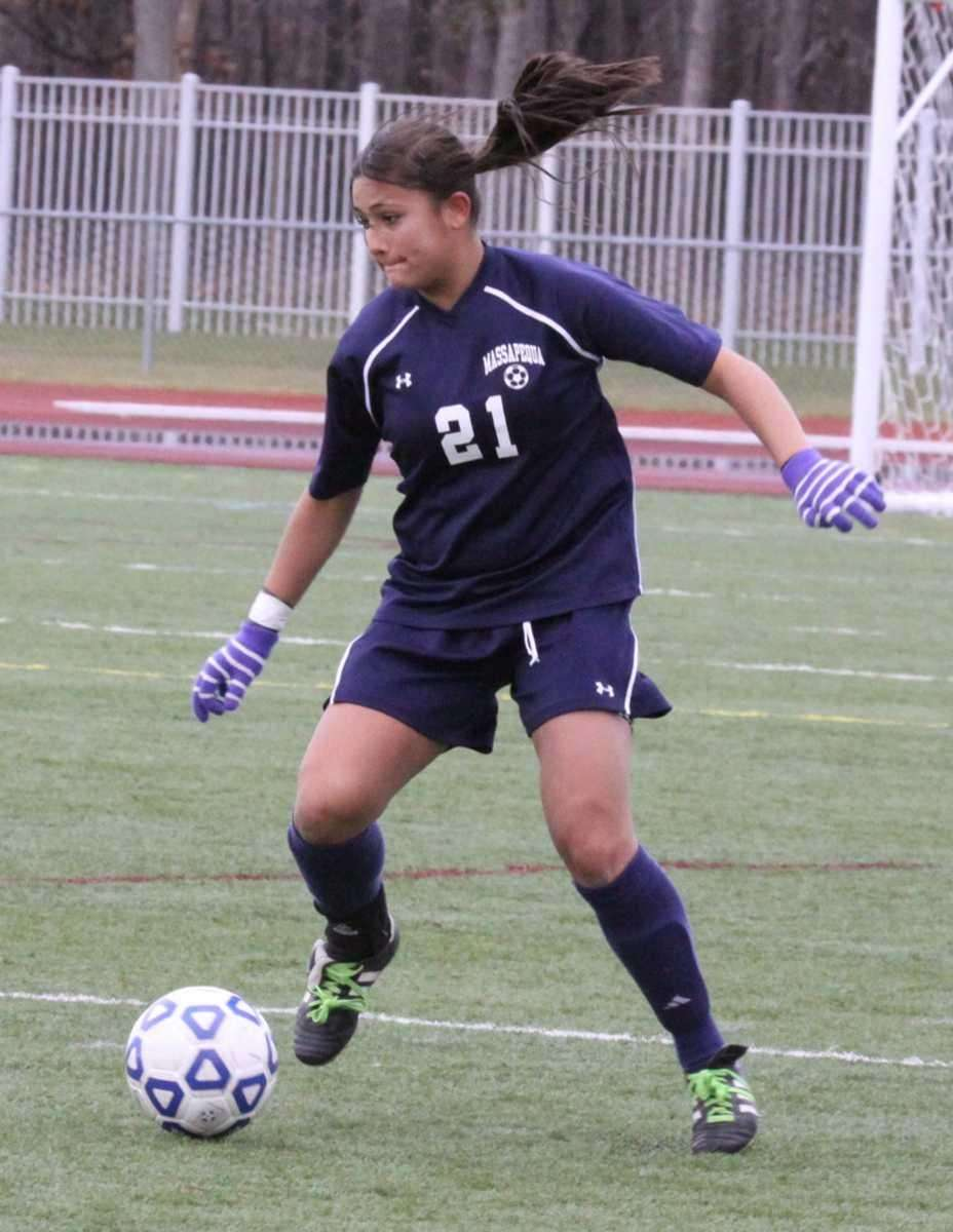 Massapequa's Victoria Maley kicks the ball up field