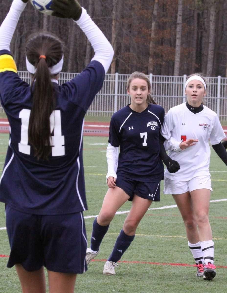 Massapequa's Stephanie Nelle throws the ball to Anna