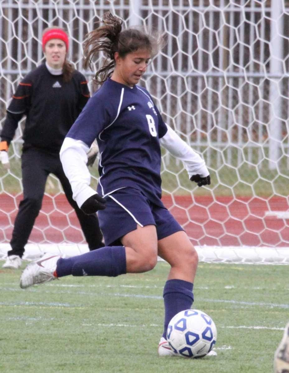 Massapequa's Erica Modena kicks the ball up field