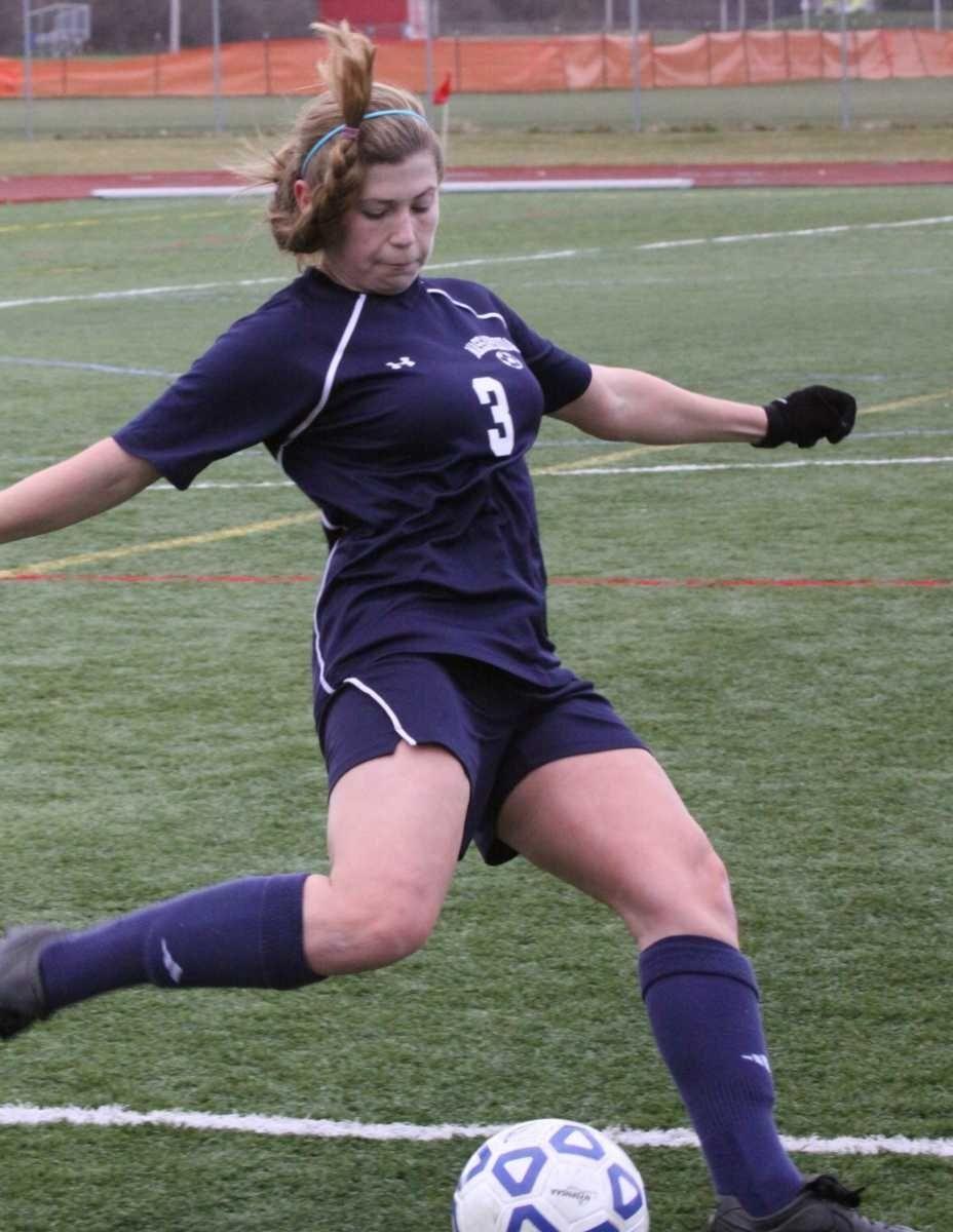 Massapequa's Jamie Strumwasser kicks the ball up field