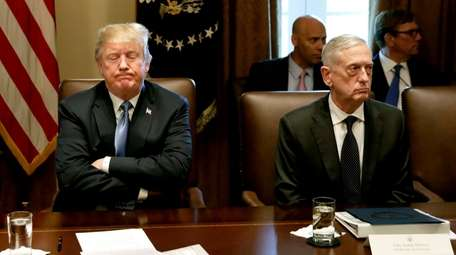 President Donald Trump, left, pauses while speaking as