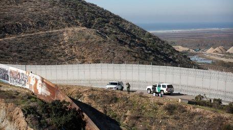 Honduran asylum seekers are taken into custody by