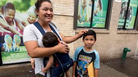 Eilyn Carbajal, from Honduras, is reunited with her