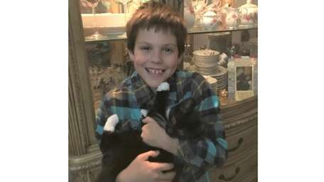 Kidsday reporter Jagger Rocco and his cat, Mittens.