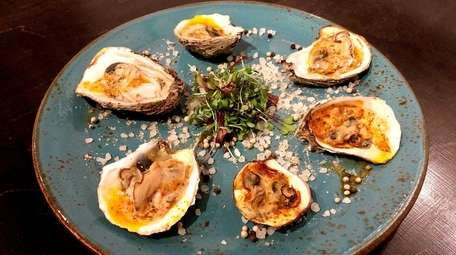 Char-grilled oysters with tomato-absinthe butter is one of