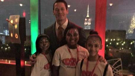 John Cena with Kidsday reporters, Varsha Ramrookum, left,