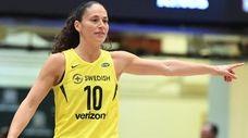 Storm guard Sue Bird gestures to teammates during
