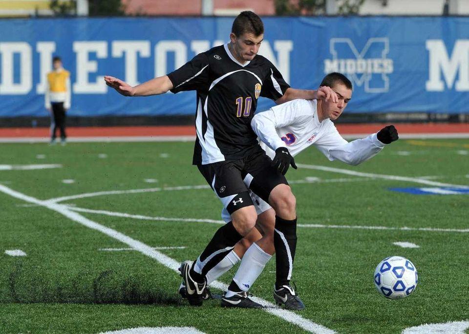 Sayville senior Vincent Sakk (10) and Goshen senior