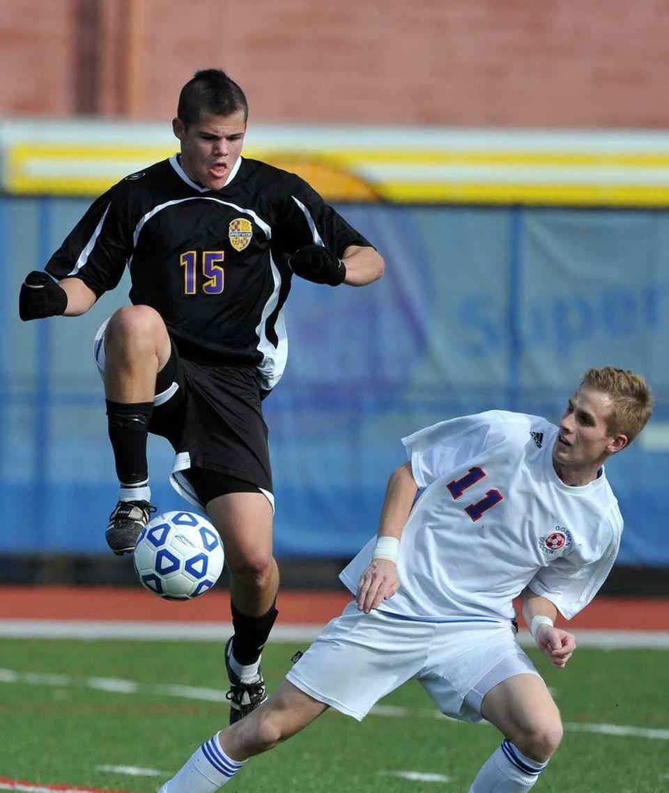 Sayville sophomore Robert Hammerle (15) plays the ball