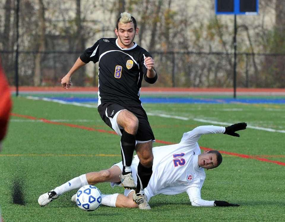 Goshen junior Matt Mungo (12)falls to the ground