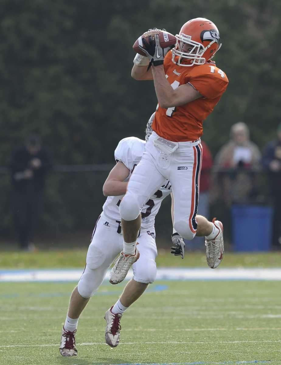 Carey's Stephen Marino pulls in a pass from