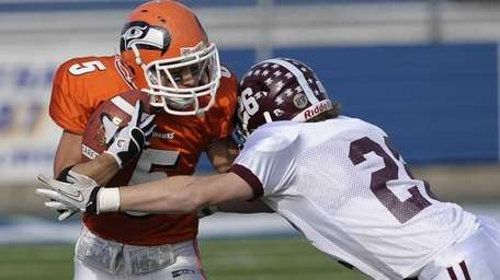 Carey's Rob Miotto is tackled by Garden City's