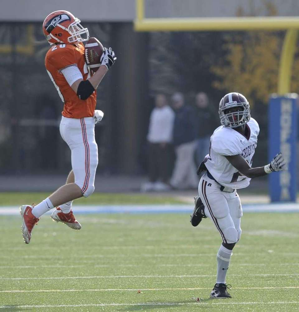 Carey's Giuliano Bove intercepts a pass intended for