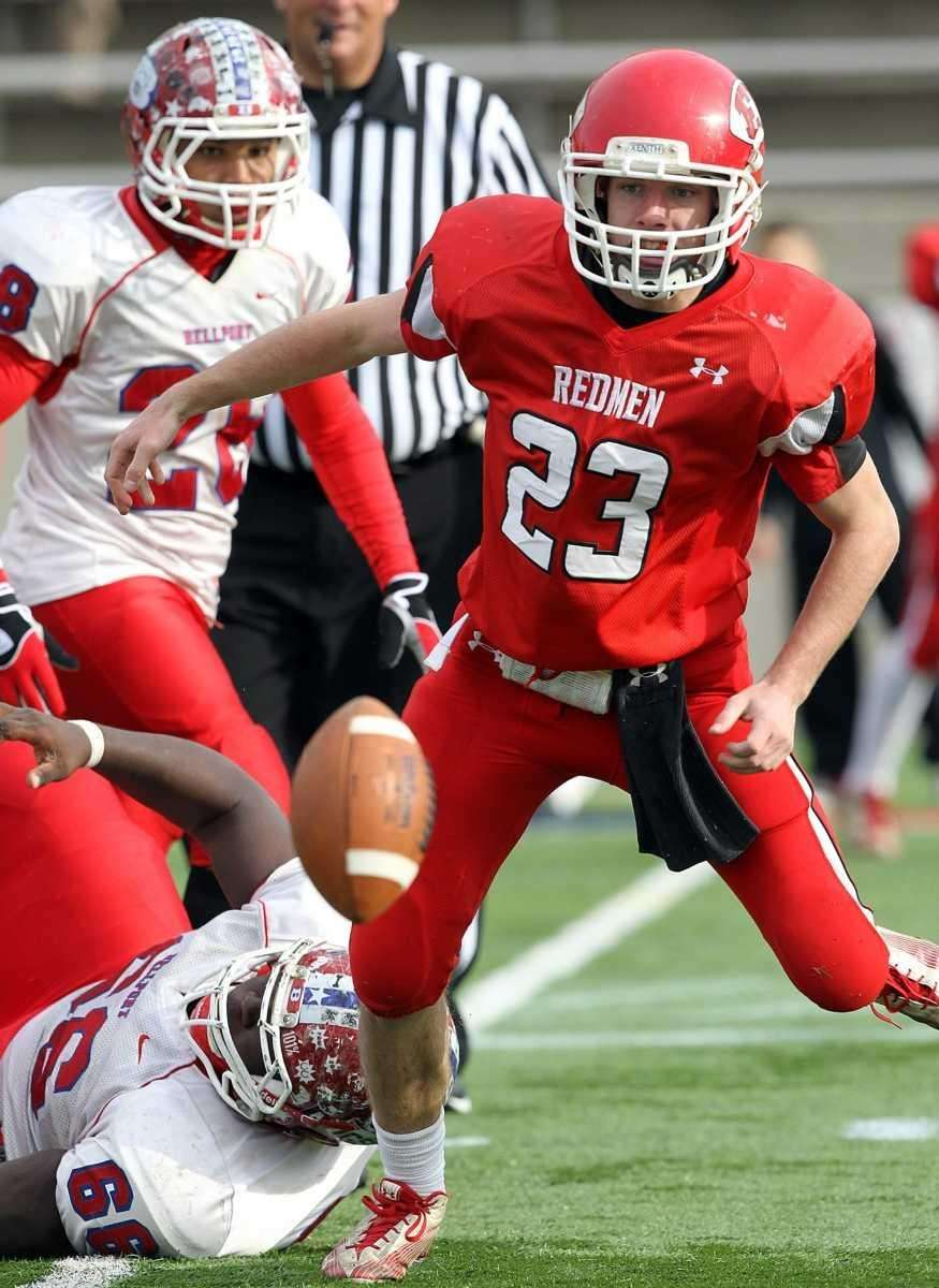 East Islip quarterback Kevin Hutchinson (23) has the