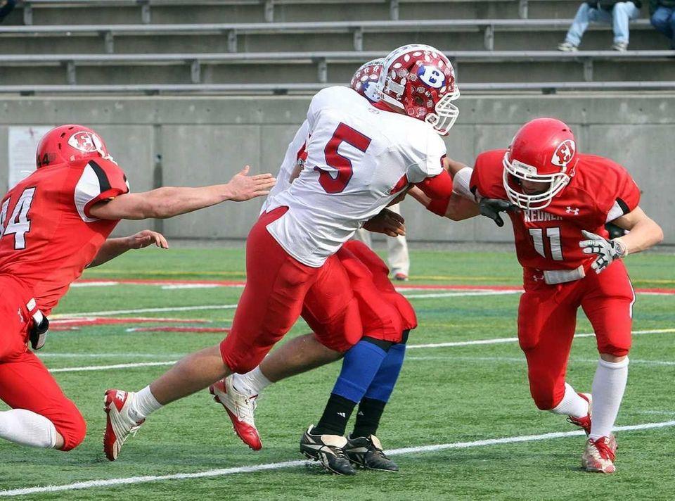 Bellport quarterback Aaron Rodriguez (5) takes it into