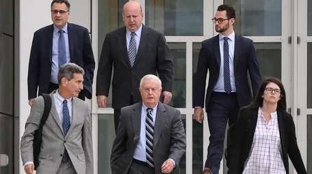 Flanked by their lawyers, former Suffolk District Attorney