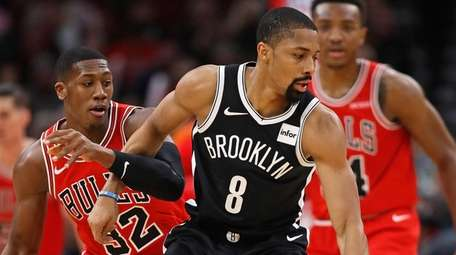 Spencer Dinwiddie, shown here riding Chicago's Kris Dunn