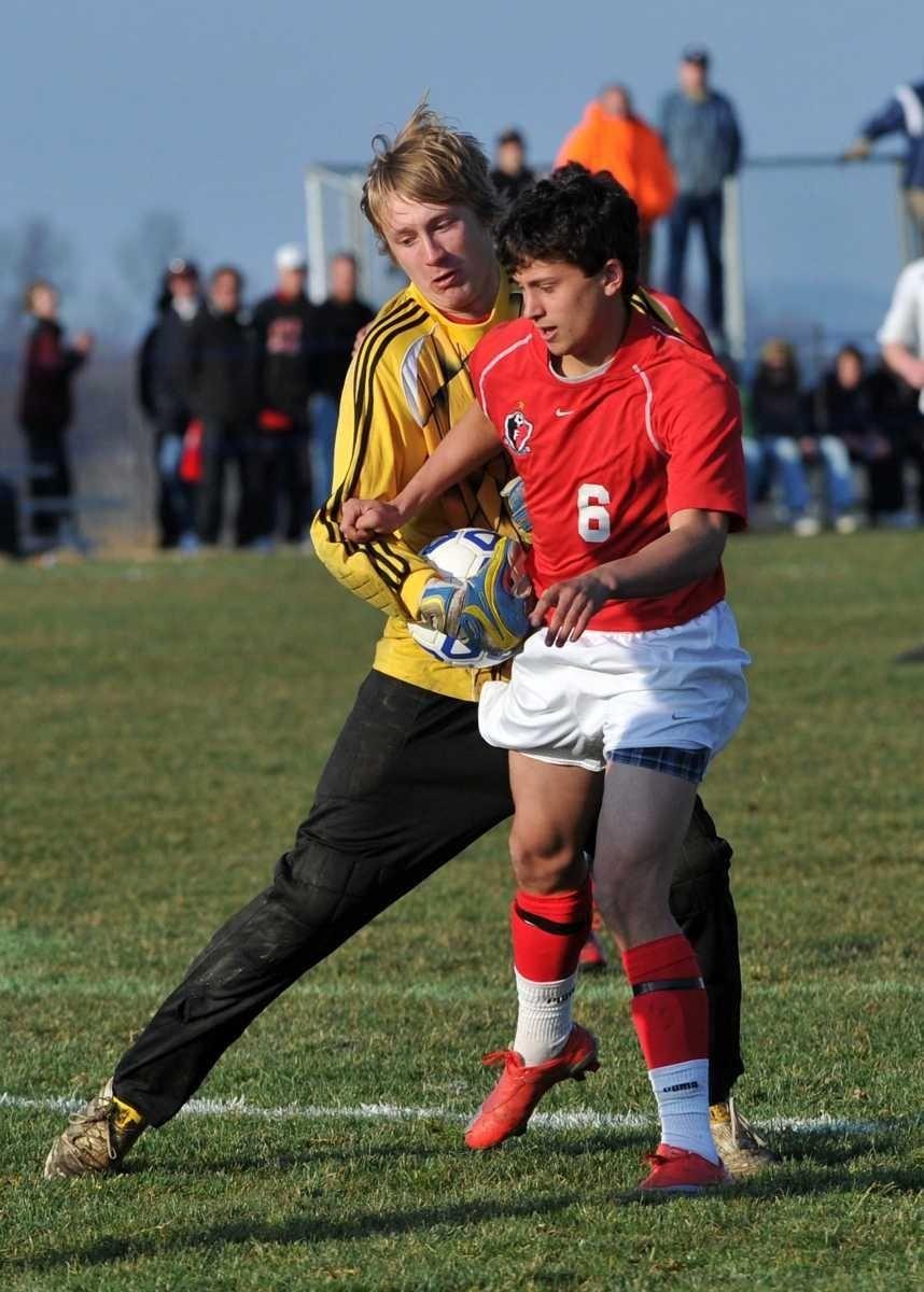 Friends Academy senior Matt Slotnick (6) and Madrid-Waddington