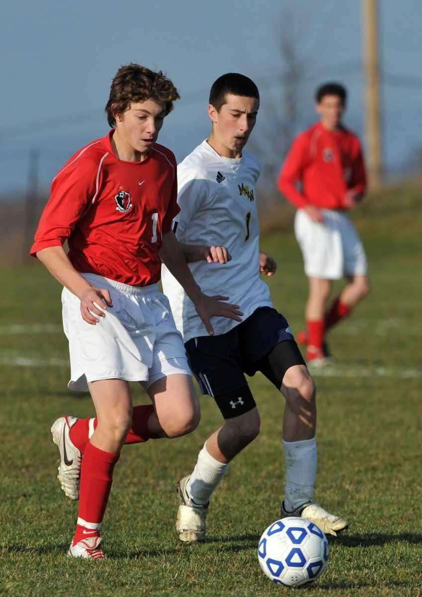 Friends Academy sophomore Kyle Dineen, left, and Madrid-Waddington