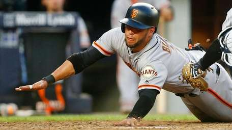 Gregor Blanco of the Giants is out at