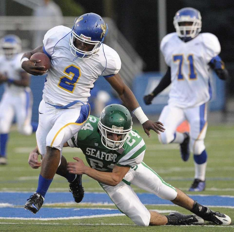 Roosevelt's Donte Colter breaks a tackle by Seaford's