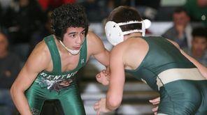 Brentwood's Fernando Romero wrestles Longwood's Nick Grariano in