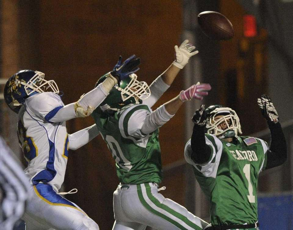 Seaford's Dan Arena, center, and Anthony Marino, right,