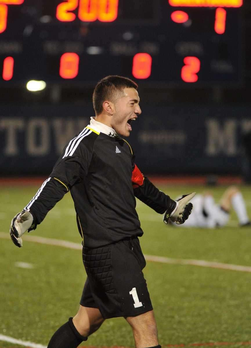 Brentwood keeper Herson Guzman reacts after his team