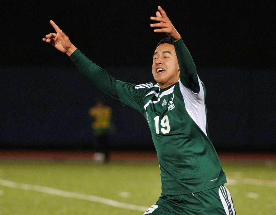 Brentwood sophomore Johnathan Interiano (19) celebrates scoring the