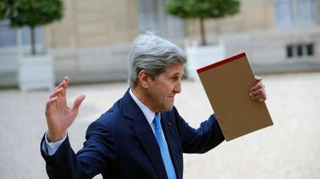 Former Secretary of State John Kerry waves to