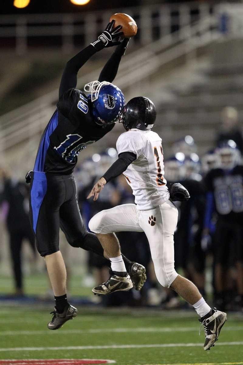 Glenn wide receiver Jon Mannix (10) leaps high
