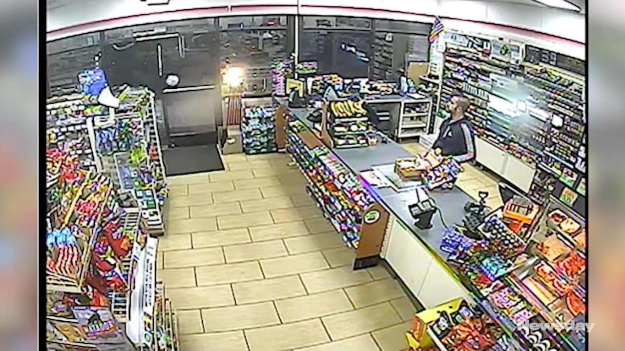 Surveillance video shows a man robbing a convenience store