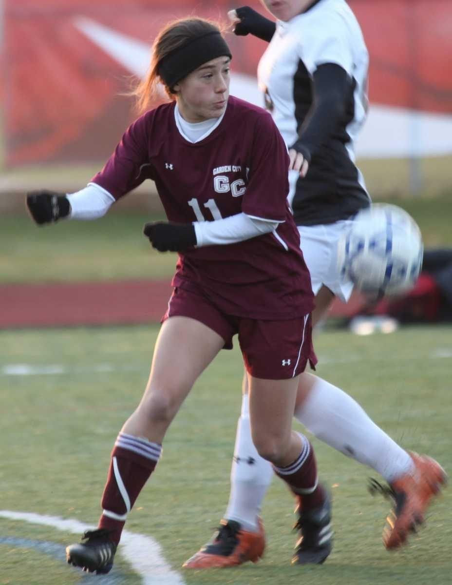 Garden City's Victoria Aldrich fights for the ball