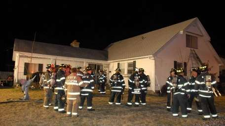 West Babylon firefighters, responding to a fire alarm