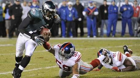 Philadelphia Eagles quarterback Michael Vick runs for a