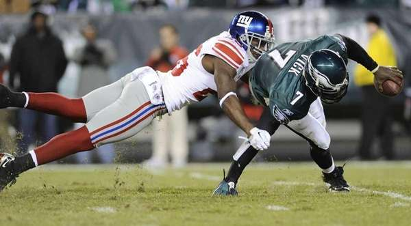Philadelphia Eagles quarterback Michael Vick scrambles out of