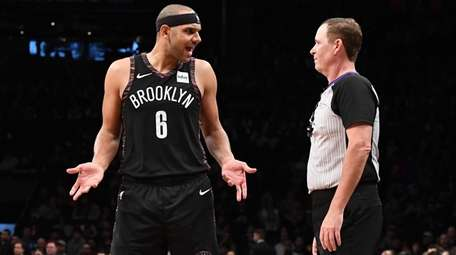 Brooklyn Nets forward Jared Dudley speaks with referee