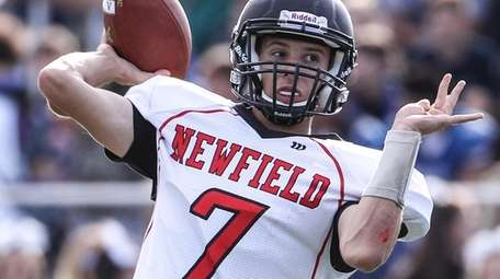 Newfield quarterback Max Martin looks to pass during