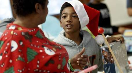 K'Dreese Turner, 10, receives gifts during the New