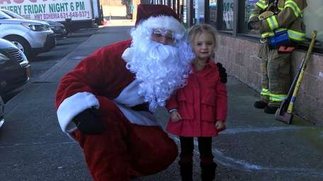 The West Sayville Fire Department's Santa poses with