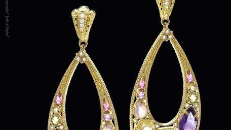 This pair of 18 karat gold tear drop