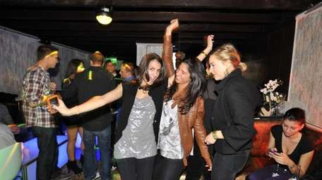 Friends dance to the pulsating music at the